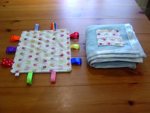 Taggie comforter and fleece blanket